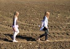 Kids - girls walking on field Stock Photo