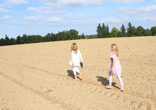 Kids - girls walking on field Royalty Free Stock Image
