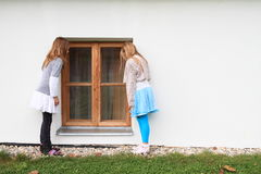 Kids - girls watching into window Royalty Free Stock Images