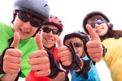 Kids giving thumbs up  Royalty Free Stock Photo
