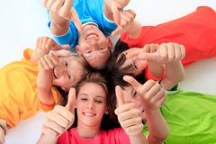 Kids giving thumbs up Stock Images