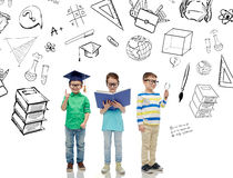 Kids in glasses with book, lens and bachelor hat Royalty Free Stock Photos