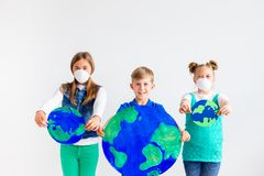 Kids with a globe. A portrait of kids with a globe Stock Photography