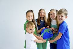Kids with a globe. A portrait of kids with a globe Royalty Free Stock Images