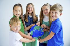 Kids with a globe. A portrait of kids with a globe stock photos