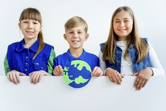 Kids with a globe. A portrait of kids with a globe Royalty Free Stock Image