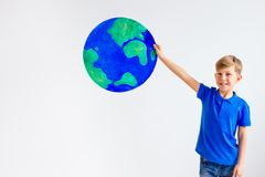 Kids with a globe. A portrait of kids with a globe Royalty Free Stock Photo