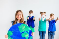 Kids with a globe. A portrait of kids with a globe Stock Image