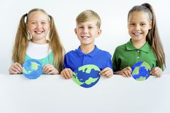Kids with a globe. A portrait of kids with a globe Royalty Free Stock Photography