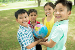 Kids with globe stock photography