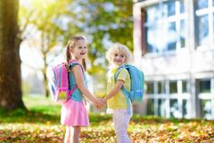 Kids go back to school. Child at kindergarten. Children go back to school. Start of new school year after summer vacation. Boy and girl with backpack and books stock image