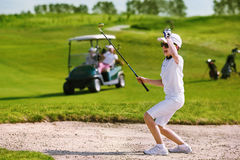 Kids golf competition. Boy playing golf and enjoing on the successful hit Royalty Free Stock Photos