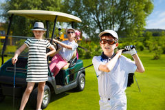 Kids golf competition. Children playing golf on kids competition in golf course at summer day Stock Photography