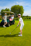 Kids golf competition. Children playing golf and taking part on kids competition in golf course at summer day Royalty Free Stock Images