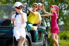 Kids golf competition. Children playing golf and taking part on kids competition in golf course at summer day royalty free stock photo