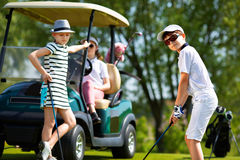Kids golf competition. Children playing golf and taking part on kids competition in golf course at summer day stock images