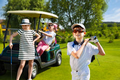 Kids golf competition. Children playing golf and taking part on kids competition in golf course at summer day Royalty Free Stock Photos