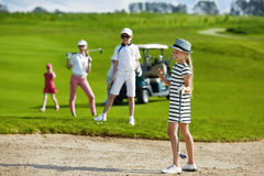 Kids golf competition. Girl playing golf and  enjoing on the successful hit Stock Images