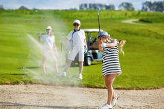 Kids golf competition. Girl playing golf and  hitting from bunker Stock Photography