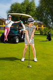 Kids golf competition. Girls playing golf at golf range at summer day Stock Images