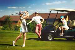 Kids golf competition. Girls playing golf at golf range at summer day Stock Photos