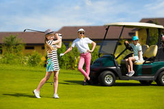 Kids golf competition. Girls playing golf at golf range at summer day Royalty Free Stock Photography