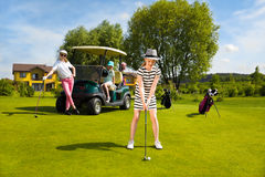 Kids golf competition. Girls playing golf at golf range at summer day Royalty Free Stock Photos