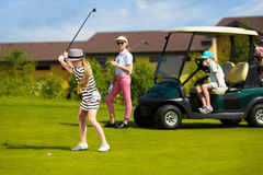 Kids golf competition. Girls playing golf at golf range at summer day Royalty Free Stock Photo