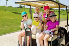 Kids golf competition. Girls walking in golf car at golf course at summer day Royalty Free Stock Photo