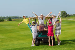 Kids golf competition. Happy children posing near golf car at golf course at summer day Stock Photography