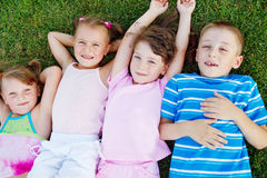 Kids on grass Royalty Free Stock Image