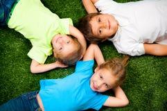 Kids on grass Stock Photos