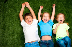 Kids on grass Royalty Free Stock Photos