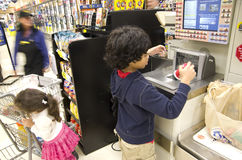 Kids grocery shopping. Kids were checking out at grocery store Stock Photo