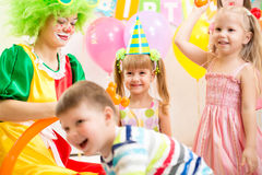 Kids group and clown on birthday party Stock Photo