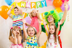 Kids group and clown on birthday party Stock Photos
