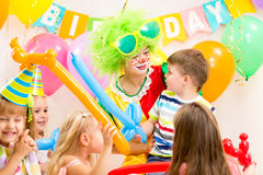 Kids group and clown celebrating birthday party Stock Photography
