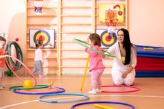 Kids group with colorful hula hoops royalty free stock photography
