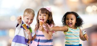 Happy kids group eating ice cream at a party royalty free stock image