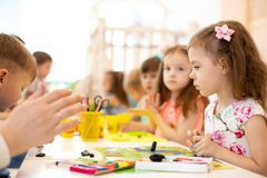 Kids group learning arts and crafts in daycare centre. Kids group learning arts and crafts in kindergarten or day care centre stock image