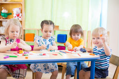 Kids group learning arts and crafts in kindergarten with interest Stock Image