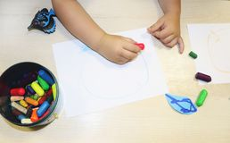 Kids group making arts and crafts in kindergarten. Children spending time in day care centre with the great interest. Children spending time in day care centre royalty free stock images