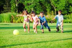 Kids group playing with ball. In the backyard royalty free stock photos
