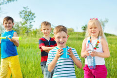 Kids group with toy water guns Stock Photos