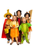 Kids with Halloween attributes in stage costumes Stock Images
