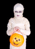Kids in Halloween costume. Child dressed as a mummy Halloween costume holding a trick or treat bucket Stock Images
