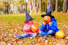 Kids in halloween costume play at autumn park. Kids trick or treating Royalty Free Stock Photos