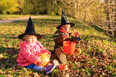 Kids in halloween costume play at autumn park Stock Photo