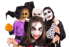 Kids in Halloween costumes. Kids with face-paint and Halloween costumes isolated in white Stock Photo