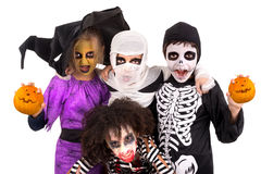 Kids in Halloween costumes. Kids with face-paint and Halloween costumes isolated in white Stock Images